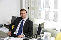 Real Estate Agent at Desk