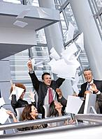 Multi_ethnic businesspeople cheering