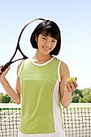 Asian woman holding tennis racket