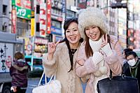 Asian women making peace sign hand gesture