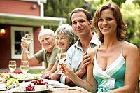 Family enjoying dinner party