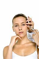 Young woman receiving botox injection, looking at camera