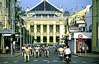 Traffic in front of the National Theater built in french colonial style, Hanoi, Vietnam