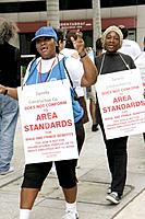 Florida, Miami, Wachovia Financial Center, protest, labor demonstration, signs, wages, fringe benefits, picket line, Black, woman,