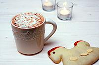 Detail view of a gingerbread cookie and a mug of hot chocolate