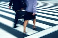 Two people crossing at the crosswalk, high angle view, blurred motion, Tokyo, Japan