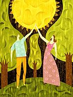 Couple in a forest, touching the sun