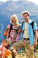 Austria, Salzburger Land, couple with son 8_9 hiking