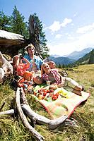 Austria, Salzburger Land, parents and son 8_9 having picnic