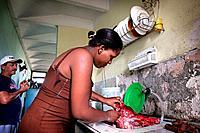 A woman in a kitchen in Havana, Cuba.