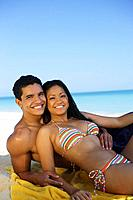 Hawaii, Oahu, Couple posing on the beach.