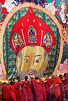 Monks unrolling a huge thangka or thongdrel representing the shabdrung, Bhutan´s greatest ruler, punakha tsechu festival, punakha, Bhutan