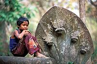 CHILD AND NAGAS, BENG MEALEA TEMPLE XIITH CENTURY, ANGKOR REGION, CAMBODIA