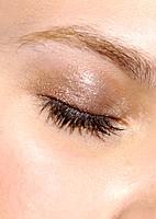 Close_up of a closed eye of a woman
