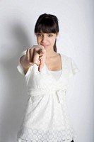 Young woman pointing with her finger