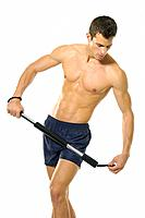 Young man exercising with a chest toner