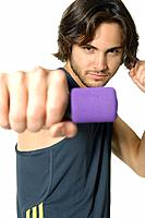 Close_up of a young man exercising with hand weight