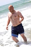 sporty man at the beach
