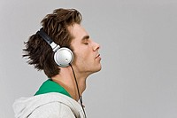 Young man Listening to Headphones, close_up