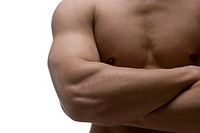 Midsection of muscular man with folded hands