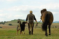 woman with icelandic horse and dog _ taking a walk
