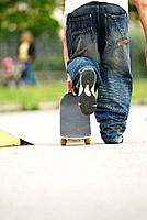 male teenager with skateboard