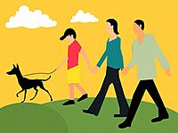 Side view of family walking with their pet