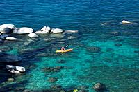 A Man Sea Kayaking on Lake Tahoe in California