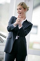 business, businesswoman, young, blond, cheerfully, gesture, semi_portrait,