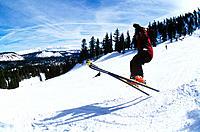 A skiier jumping