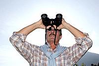 Senior, actively, gaze, binoculars, mountain scenery,