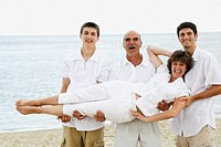 Men Carrying Woman at the Beach