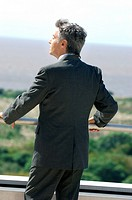 Mature businessman standing in balcony