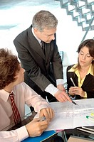 Businessman in discussion with colleagues in office