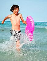 Boy at the sea with a float