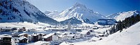 Aerial view of town on snow_covered landscape, Arlberg, Austria