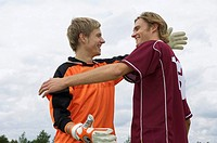 Kicker and goalkeeper embracing each other