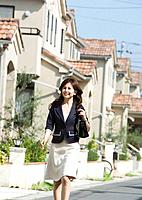 Woman walking around the residential district