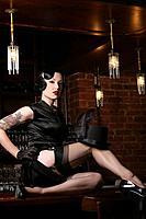 Young sexy woman in burlesque bar.
