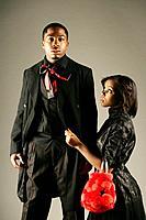 Young stylish African American couple, studio shot.