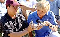 Channel 11 TV newscaster interviews member Asian Pigeon racing Club  Hmong Sports Festival McMurray Field St Paul Minnesota USA