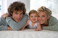Portrait happy parents with baby