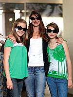 Mother and two girls shopping