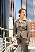 Mature Asian businesswoman outside