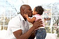 African father kissing daughter
