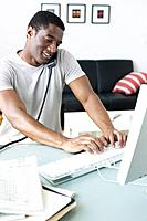 African businessman working on computer in office