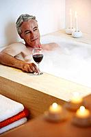 Senior man taking bubble bath