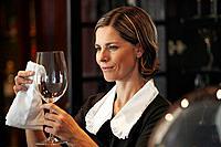 Maid polishing wine glass