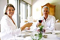 Woman and man holding wine glasses