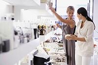 Women in cosmetics shop